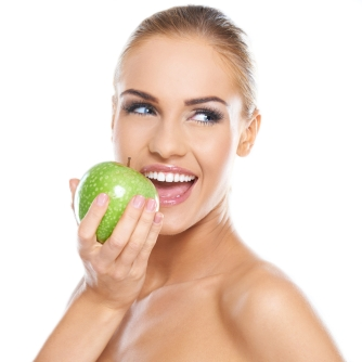 woman-with-bright-smile-eating-an-apple.jpg